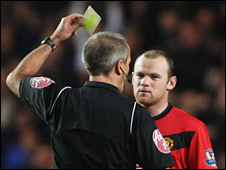 Wayne Rooney is booked by referee Martin Atkinson during Man Utd's defeat by Chelsea