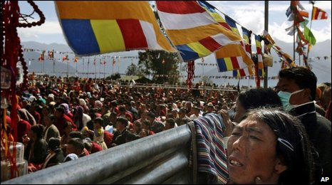 Buddhist devotees attend prayer meetings and teaching sessions held by Tibetan spiritual leader, the Dalai Lama, unseen, in the Himalayan town of Tawang, near the frontier with Chinese-controlled Tibet, Arunachal Pradesh state, India, Tuesday, Nov. 10, 2009.