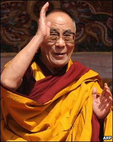 Tibetan spiritual leader the Dalai Lama gestures to his followers as he presides over teachings at Yid-Gha-Choezin in Tawang, in the northwestern corner of Arunachal Pradesh state on November 10, 2009