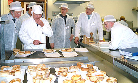 Robert Ross, chief judge, from Edinburgh, samples some of the pies