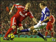 "Liverpool""s Martin Skrtel (left) and Birmingham City""s Lee Bowyer (right) battle for the ball"