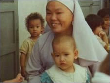 Vikki as a baby with nurse in Saigon