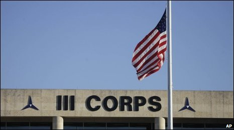 "The US flag flies at half mast in front of the Army""s III Corps headquarters at Fort Hood, Texas"