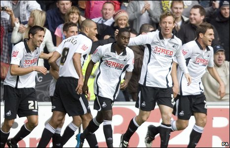 Swansea's players celebrate after taking the lead through Nathan Dyer