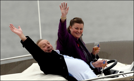 Les Scadding and Samantha Peachey-Scadding celebrate their win on a powerboat in Cardiff Bay