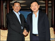 former Thai Prime Minister Thaksin Shinawatra (R) shaking hands with Cambodian Prime Minister Hun Sen (L)
