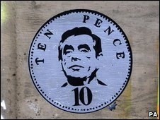 Graffiti depicting Gordon Brown on a 10p coin, near Waterloo, Lo