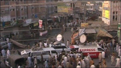 The aftermath of the car bombing in north-western Pakistani town of Charsadda