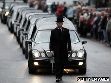 Hearses carrying the coffins of six dead soldiers