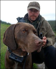 Wildlife ranger Ally Macaskill and Max who wears the GPS locator