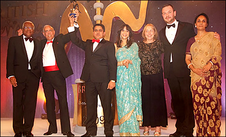 Vijay Bhagotra (second from left) receives his award