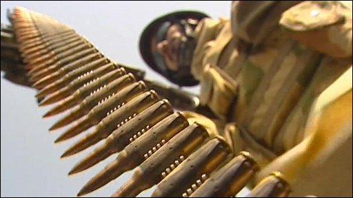 Soldier and gun