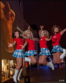The Scottish Rockettes jump for joy at an image of Chris Cusiter