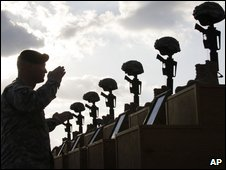Soldiers salute as they honor victims of the Fort Hood shooting at a memorial service