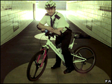 A police constable on a bike