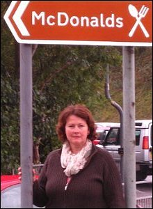 Angela Burns AM under the McDonald's sign