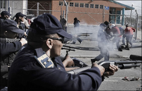 Policemen in South Africa firing rubber bullets