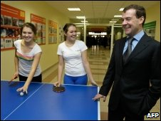 Dmitry Medvedev with teenage pingpong players at a school