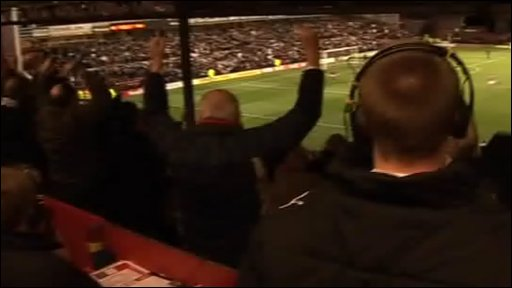 Fans celebrate a goal at the City Ground