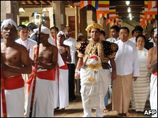Sacred Tooth Relic Chief Custodian Pradeep Nilanga Dela (C) walks in a procession with visiting Myanmar leader Than Shwe  in Kandy