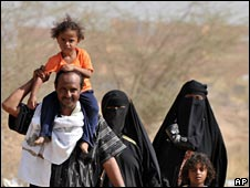 Saudi family leave their village near the Yemeni border