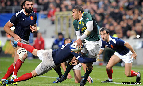 France wing Vincent Clerc tackles opposite number Bryan Habana