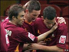 Bradford celebrate Gareth Evans' equaliser