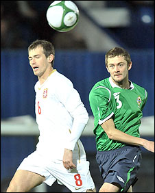 Danko Lazovic of Serbia in action against NI's George McCartney