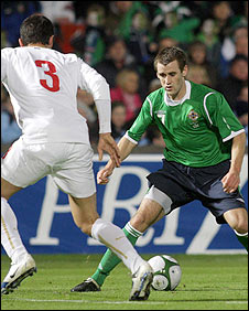 Serbia's Aleksandar Kolarov in action against NI's Niall McGinn