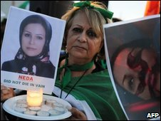 An Iranian woman holds up a picture of Neda Soltan during a protest in Los Angeles in June