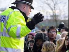 Policeman gestures to crowd. Picture by Tom Thorpe
