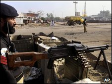 A Pakistani officer near the scene of a car bomb in Peshawar, Pakistan