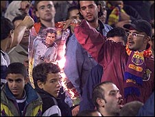 Barcelona fans burn a picture of Luis Figo