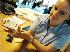 Woman holding ID card