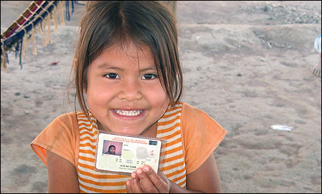 Five-year-old Bolivian girl with her identity card (Photo: Plan)