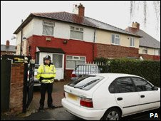 Police officer outside property on Bowdon Avenue, Fallowfield