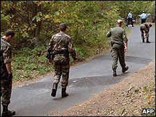 French gendarmes search woods near Fountainebleau after the killing of jogger Marie Christine Hodeau on 30/09/09
