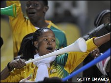 South African football fans with vuvuzelas