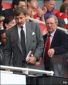 Kroenke and Peter Hill-Wood heads for their seat in the directors' box