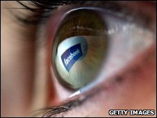 Facebook logo refelcted in girl's eye