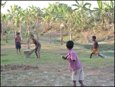 Village boy play cricket (BBC)