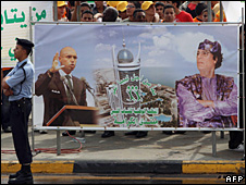 Archive photo of a banner in Tripoli showing Libyan leader Muammar Gaddafi (r) and his son Saif al-Islam (l), October 2008