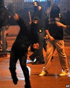Masked youths throw stones at police in Athens