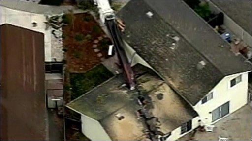 A Santa Rosa home split by a crane