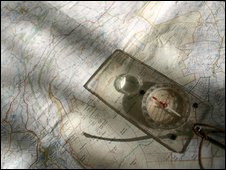 Ordnance Survey map and compass