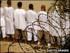 Detainees stand during an early morning Islamic prayer at Guantanamo Bay