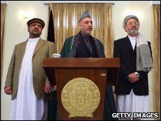 Afghan President Hamid Karzai (C) addresses a press conference with his two vice presidents Mohammad Qasim Fahim (L) and Karim Khalili (R) at the Presidential Palace on November 3, 2009 in Kabul, Afghanistan.
