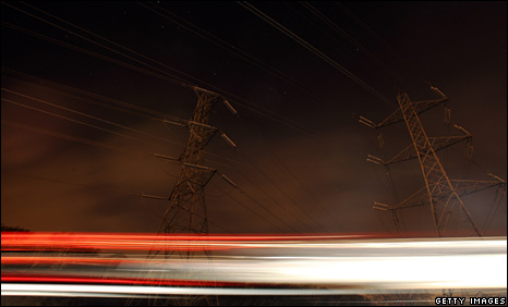 Car passing electricity towers