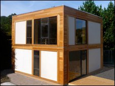 House built from pre-fabricated straw-bale and hemp panels
