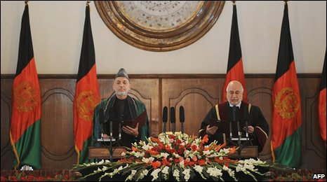 Karzai (L) and Chief Justice Abdul Salam Azimi during the swearing in ceremony at the Presidential Palace in Kabul